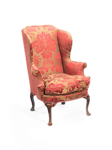 A walnut and upholstered wing-back armchair