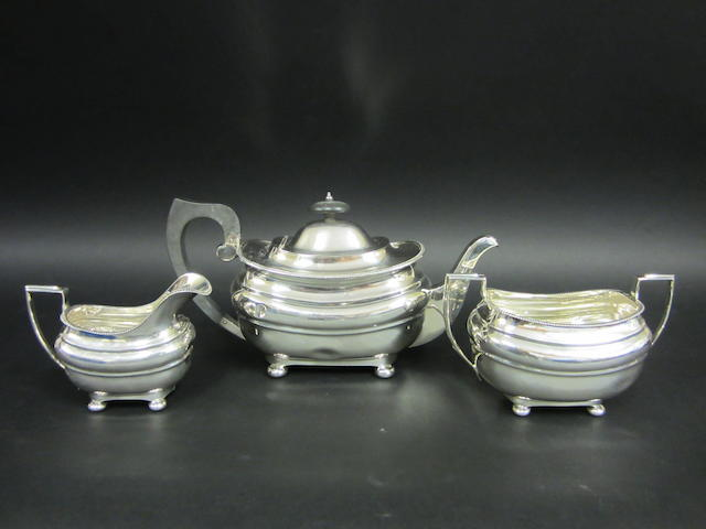 A silver three piece tea service Chester 1932