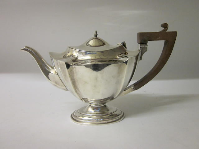 A George V silver tea pot marks rubbed Birmingham 1925,