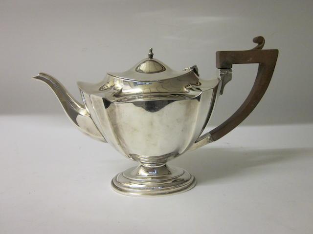 A George V silver tea pot marks rubbed Birmingham 1925,