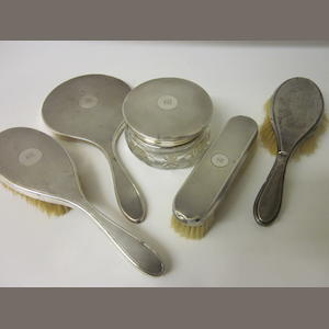 A four piece matching silver dressing table set,   Mixed makers Birmingham 1929, London 1928  (5)