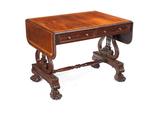 A Regency Irish carved mahogany sofa table in the manner of Mack, Williams and Gibton