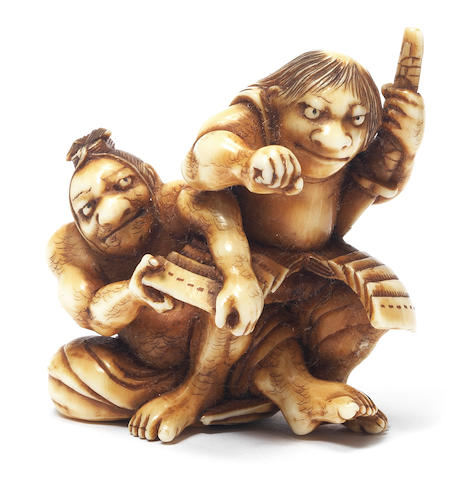 An ivory netsuke of Asahina Saburo and Soga no Goro Attributed to Matsushita Otoman, Hakata, 19th century