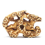A rare ivory netsuke of a running kirin 19th century