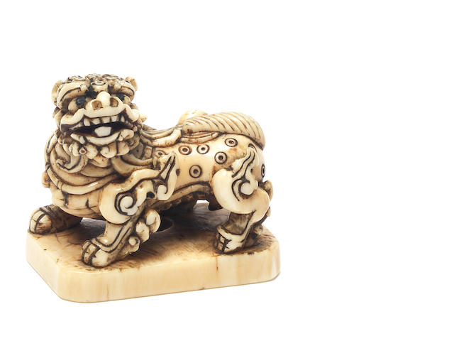 An unusual ivory netsuke of a shishi Late 18th/early 19th century
