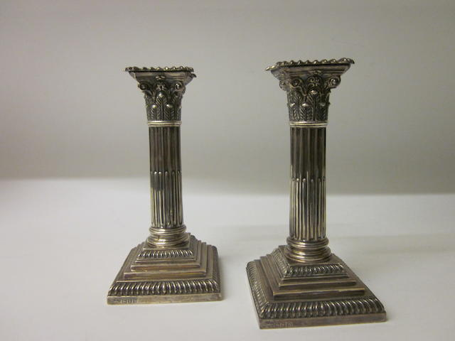 A pair of silver candlesticks by Goldsmiths and Silversmith s Co Ltd, London 1908,  (2)