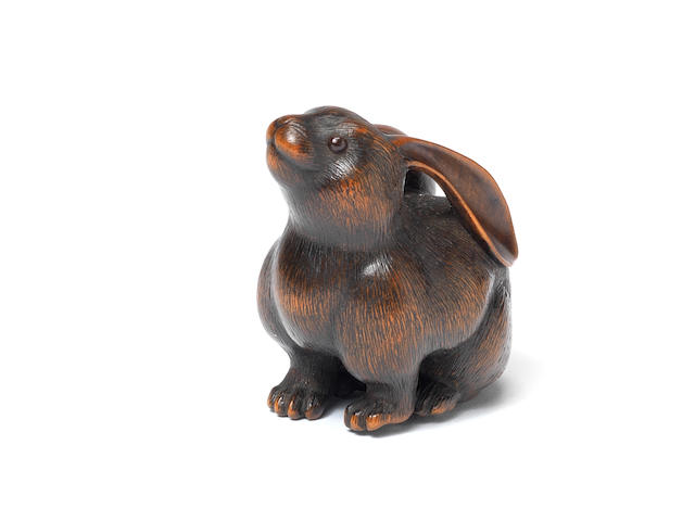 A fine wood netsuke of a seated female hare By Naito Toyomasa (1773-1856), Tanba, early 19th century