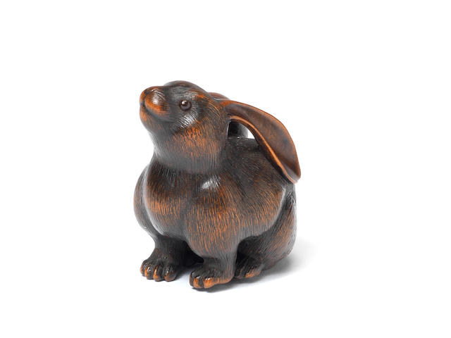 A fine wood netsuke of a female hare By Naito Toyomasa (1773-1856), Tanba, early 19th century