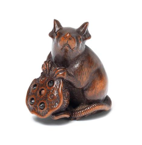 A wood netsuke of a seated rat By Matsuda Sukenaga (1810-1871), Takayama, Hida Province, 19th century