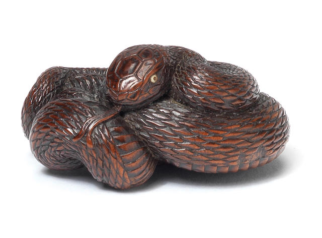 A wood netsuke of a snake By Tadatoshi, Nagoya, 19th century