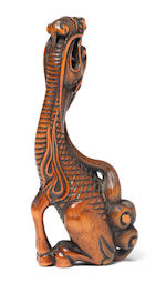 A fine wood netsuke of a kirin Kyoto, Late 18th century