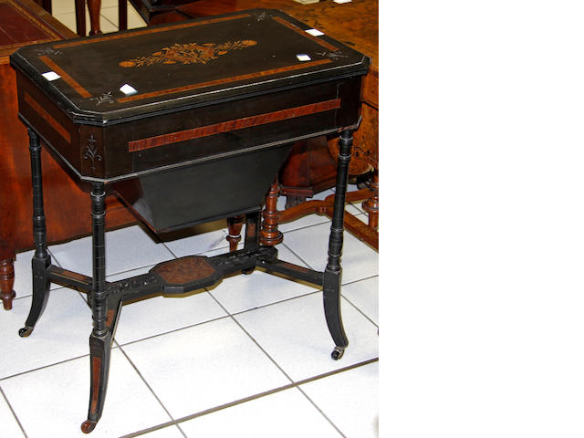 A late Victorian ebonised and amboyna inlaid work table,
