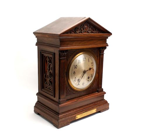An Edwardian oak mantel clock