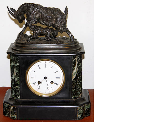 A late 19th century slate and marble clock with spelter goat surmount