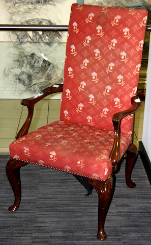 A pair of George II style walnut framed elbow chairs,
