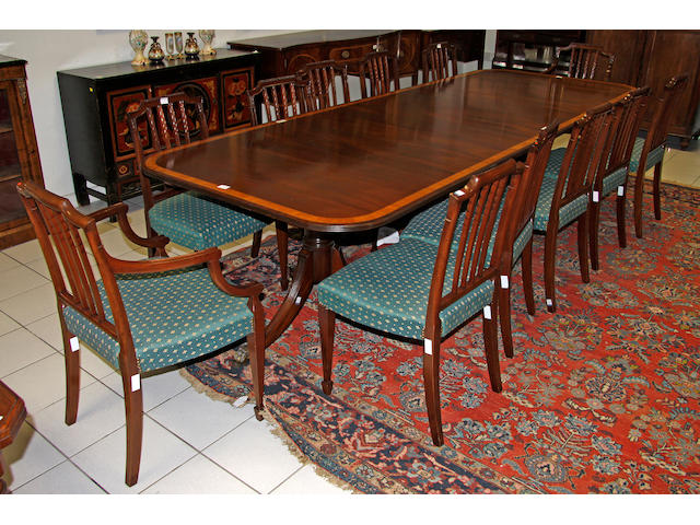 A Brett reproduction mahogany and satinwood banded 'D' end twin pillar dining table, (14)