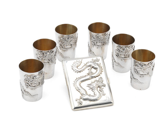 Six chinese silver toto cups and a cigarette case