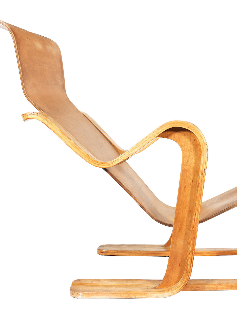 Marcel Breuer for Isokon Furniture Company A Long Chair designed and executed in 1936  paper label for Isokon Furniture Company, London, Isokon Long Chair birch faced moulded plywood  Height: 75 cm.                29 1/2 in. Length: 132 cm. approx.                51 15/16 in.