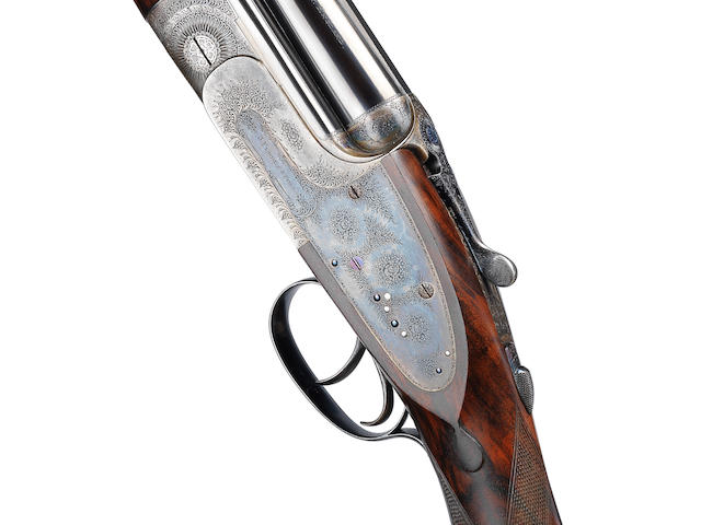 A fine 12-bore (2¾in) over-and-under sidelock ejector gun by J. Purdey & Sons, no. 26590 The whole in its brass-mounted oak and leather case with canvas cover