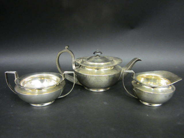 A silver three piece tea service by James Dixon and Sons, Sheffield 1923,  (3)