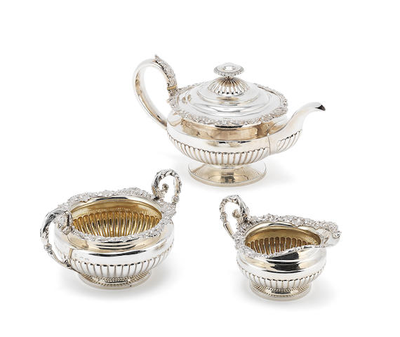 A George IV matched silver three-piece tea service teapot, by John James Keith, London 1828, sugar bowl, maker's mark distorted probably by W, C & H Eley, London 1826, the cream jug, by William Eley II, London 1825  (3)