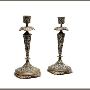A pair of late 19th century French Cloissone enamel candlesticks