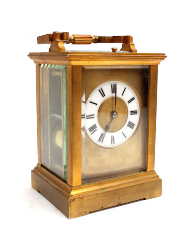 An early 20th century French Gilt brass repeating carriage clock
