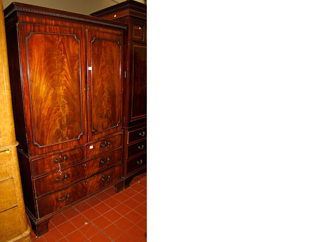 An early 19th Century mahogany linen press converted for hanging
