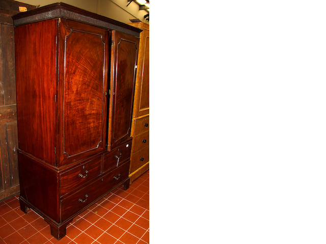 An early 19th Century mahogany linen press, converted for hanging