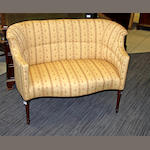 An Edwardian mahogany framed tub shaped two-seater settee,
