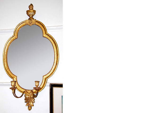 An early 19th Century gilt wood girandole (restored, re-gilded and with later plate)