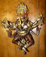 An Indian Sub-Continental gilt bronze figure of Ganesh