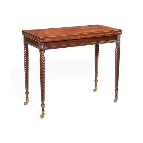 A Regency mahogany and rosewood crossbanded card table
