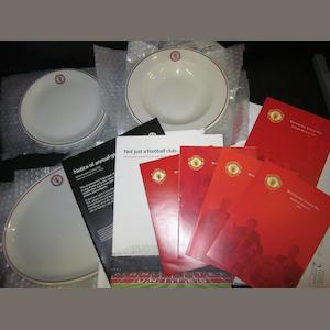 A collection of Manchester United annual reports and Royal Doulton crockery