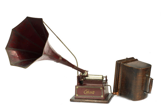 An Edison phonograph with horn and case of wax cylinders