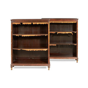 A pair of 19th century rosewood open bookcases