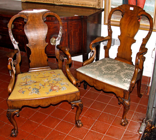 A good pair of early-mid 20th century, George I style, stained walnut elbow chairs