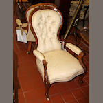 A Victorian walnut spoon-back armchair