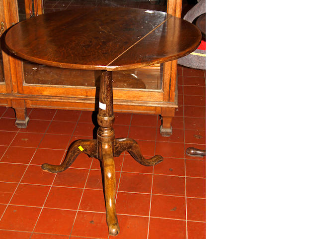 An early 19th century oak tripod table