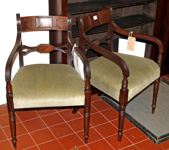 A pair of early 19th century mahogany elbow chairs