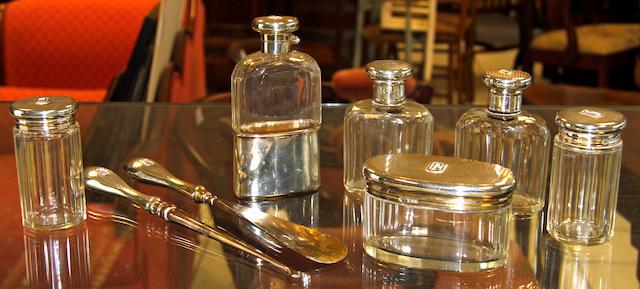 A silver gilt mounted cut glass hip flask,