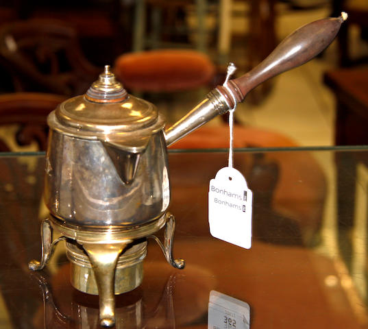 A silver brandy saucepan on stand