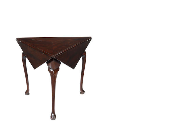 A George II Irish mahogany triform envelope table transforming to an octagonal top