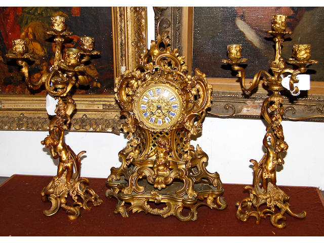 A French giltmetal clock garniture,