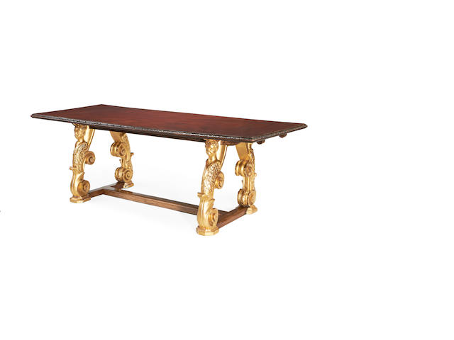 A carved giltwood and mahogany centre table