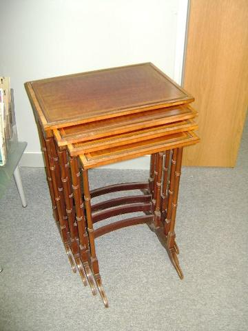 A nest of Edwardian inlaid mahogany quartetto tables,