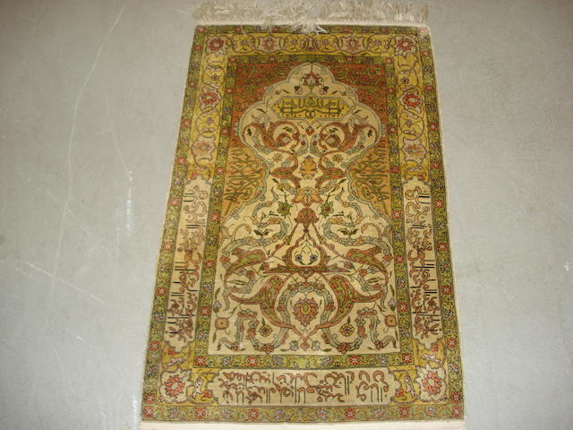 A Kayseri silk prayer rug, West Anatolia, 104cm x 63cm together with a Hereke silk and Ersari chuval (3)