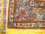 A silk Kashan rug, Central Persia, 209cm x 128cm, signed