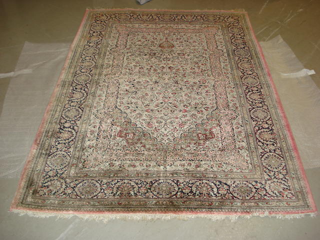 A Ghom silk prayer rug, Central Persia, 200cm x 138cm