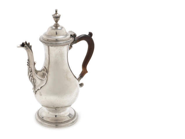 A George III silver coffee pot maker's mark overstruck by another, possibly by Hester Bateman and retailed by (?)E,  London 1780
